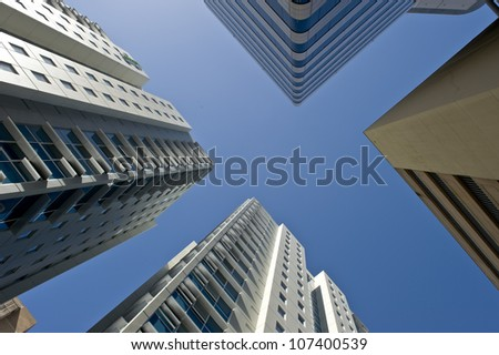 Vierw of sky scrapers against the sky in a modern city. - stock photo