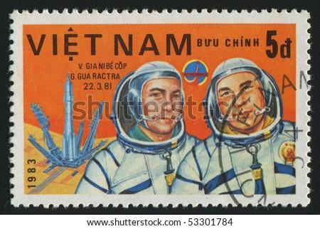 VIET NAM - CIRCA 1983: stamp printed by Viet Nam,  shows astronauts Dzhanibekov, Gurragcha, circa 1983 - stock photo