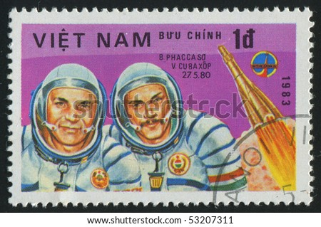 VIET NAM - CIRCA 1983: stamp printed by Viet Nam,  shows astronauts Farcas, Kubasov, circa 1983 - stock photo