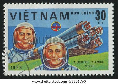 VIET NAM - CIRCA 1983: stamp printed by Viet Nam,  shows astronauts Gubarev, Remek, circa 1983 - stock photo