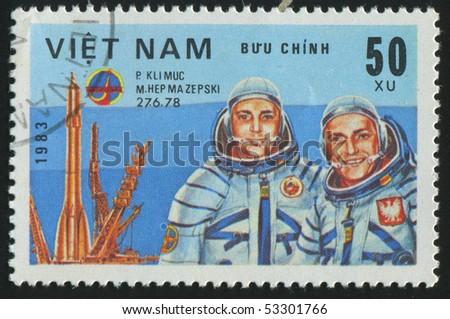 VIET NAM - CIRCA 1983: stamp printed by Viet Nam,  shows astronauts Klimuk, Hermaszewski, circa 1983 - stock photo