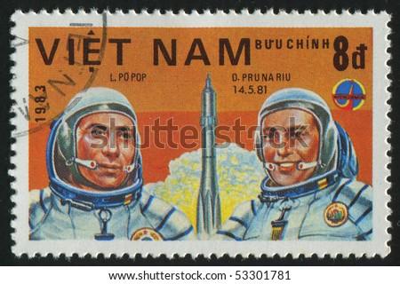 VIET NAM - CIRCA 1983: stamp printed by Viet Nam,  shows astronauts Popov, Prunariu, circa 1983 - stock photo