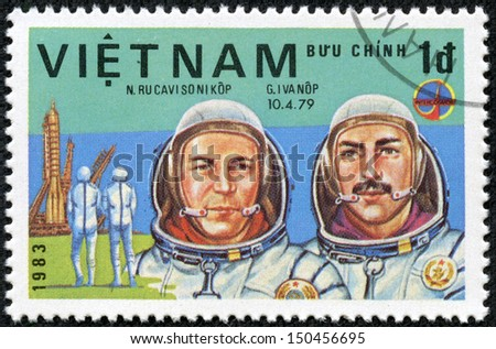 VIET NAM - CIRCA 1983: stamp printed by Viet Nam, shows astronauts Rukavishnikov, Ivanov, circa 1983 - stock photo