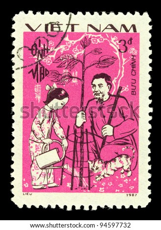 VIETNAM - CIRCA 1987: A stamp printed by Vietnam shows elderly man holds a tree, which pours girl from watering at their feet played with a kitten, circa 1987