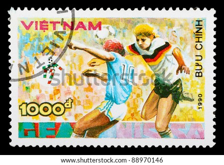 VIETNAM - CIRCA 1990: a stamp printed by Vietnam shows football players. World football cup in Italy, series, circa 1990