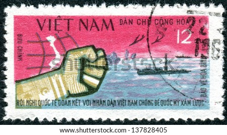 VIETNAM - CIRCA 1964: Postage stamp printed in Vietnam, depicted Fist, planes, submarine, circa 1964