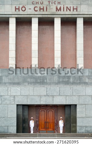 VIETNAM - DECEMBER 8:� Guards stand in front of the Ho Chi Minh Mausoleum which houses the national hero's embalmed body: President Ho Chi Minh.  - stock photo
