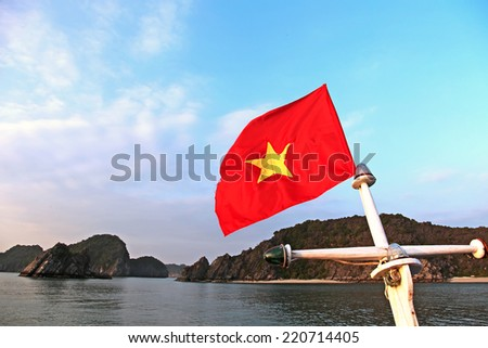 Vietnam flag on Halong Bay - stock photo
