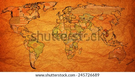 vietnam flag on old vintage world map with national borders