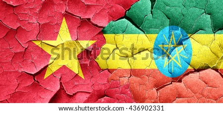 Vietnam flag with Ethiopia flag on a grunge cracked wall - stock photo
