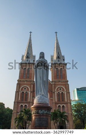 "Vietnam  2016 Jan 9, front view of ""Saigon Notre Dame Cathedral"" with madonna statue,Ho Ji Minh city, Vietnam."