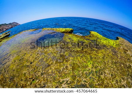 VIETNAM , JUL 20 2016 : Wonderful seascape at Nui Chua national park, Ninh Thuan, Viet Nam, waves on large rock and make amazing fall in Hang Rai at sunrise