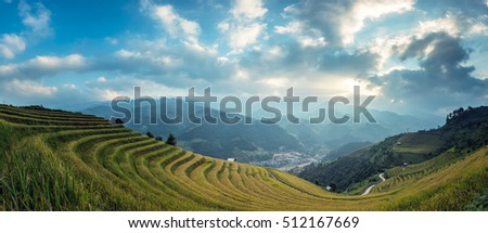 Vietnam landscape panorama scene. Vietnam Rice fields on terraced in rainy season at Mu cang chai, Vietnam. Rice fields prepare for transplant at Northwest Vietnam
