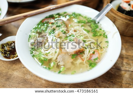 Vietnam noodle. Pho is a Vietnamese noodle soup consisting of broth, linguine-shaped, a few herbs, and meat, primarily served with either beef or chicken.