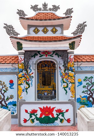 Vietnam Quang Binh Province: Shrine as altar on family grave plot in cemetery.