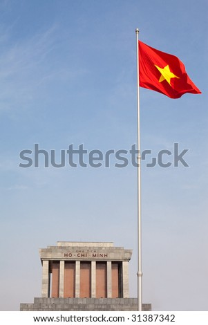Vietnam's flag flying high in front of its late leader, Ho Chi Minh's, mausoleum. - stock photo