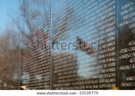 Vietnam Veterans Memorial and reflection of an American Flag - stock photo