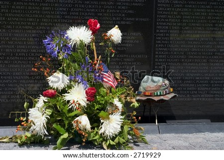 Vietnam War Memorial with Flowers and a Soldier's Hat