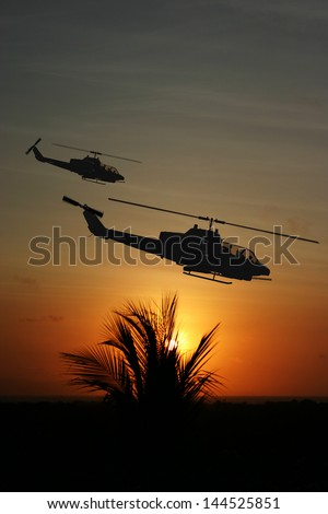 Vietnam War 'style' image circa 1970 two helicopters flying over South Vietnam looking for the North Vietnamese Army. (Artist's Impression) - stock photo