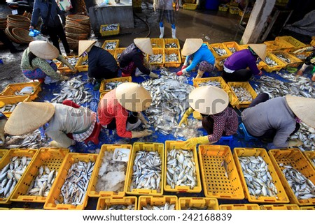 Vietnam women with conical hat are making fish in symmetry position, at Long Hai beach, VietNam - stock photo