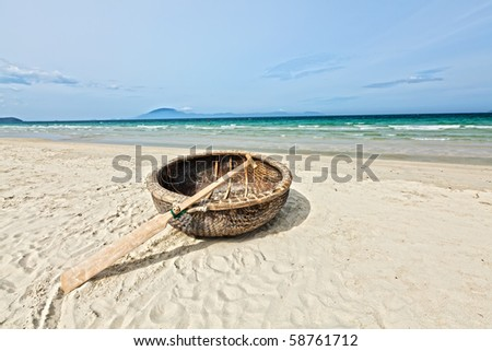 Vietnamese boat like basket near the ocean - stock photo
