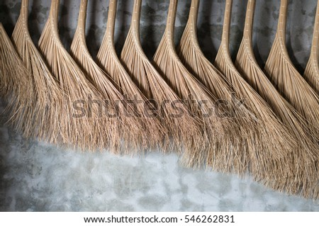 vietnamese brooms hanging on a wall