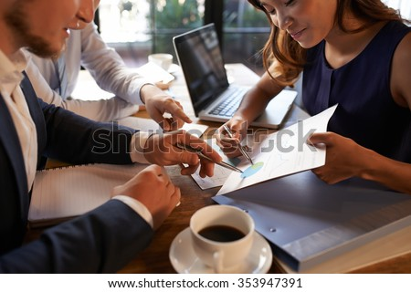 Vietnamese business lady presenting financial report to her colleagues - stock photo