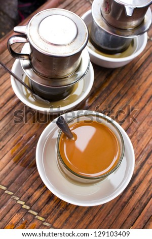 vietnamese coffee on bamboo table - stock photo