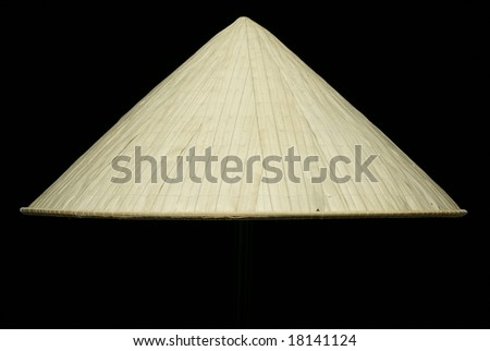 Vietnamese conical leaf hat on black background