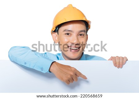 Vietnamese engineer pointing at the white board in his hand - stock photo