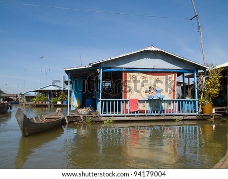 Vietnamese floating village during monsoon season on Tonle Sap river at Kampong Chhnang in Cambodia. - stock photo