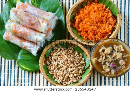 Vietnamese food, bo bia is street food, snack that delicious, cholesterol free, make from dried small shrimp, vegetables, sausage, peanut in rice paper roll, sauce, Bobia is popular snack in Vietnam - stock photo
