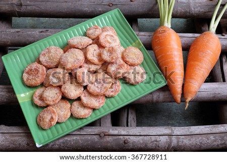 Vietnamese food for Tet holiday in spring, carrot jam, sweet eating is traditional food on lunar new year, can make from carrots cook with sugar,  amazing background for Vietnam culture