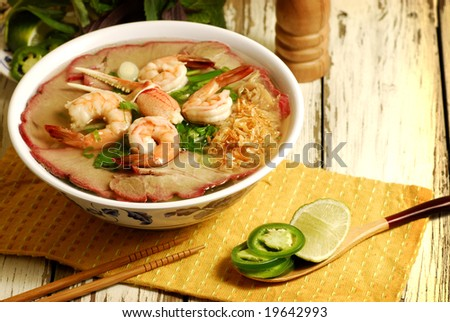 Vietnamese food on vintage table - stock photo