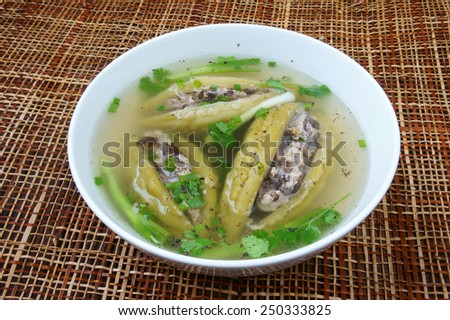 Vietnamese food, soup of bitter melon stuffed with ground meat, a nutrition, popular dish in Vietnam meal, bitter gourd rich vitamin, can anti diabetes, season with spring onion, peziza. - stock photo