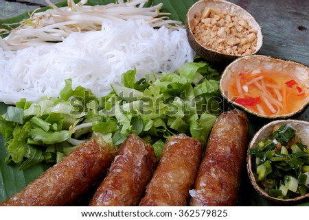 Vietnamese food, spring roll or cha gio, a delicious fried food with cylinder shape, eat with bun, salad and fish sauce, this also rich calories, cholesterol, fatty food, popular Vietnam eating - stock photo