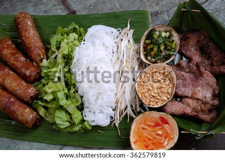 Vietnamese food, spring roll or cha gio, roast meat , a delicious fried food, eat with bun, salad and fish sauce, this also rich calories, cholesterol, fatty food, popular Vietnam eating - stock photo