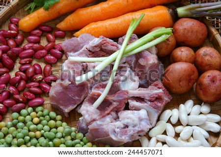 Vietnamese food, vegetable soup, fresh ingredients: potato, green pea, carrot, red bean, white bean, pork pone, raw material stew in water, season with scallion, is popular dish in Vietnam meal