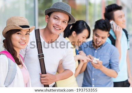 Vietnamese friends hanging out together - stock photo
