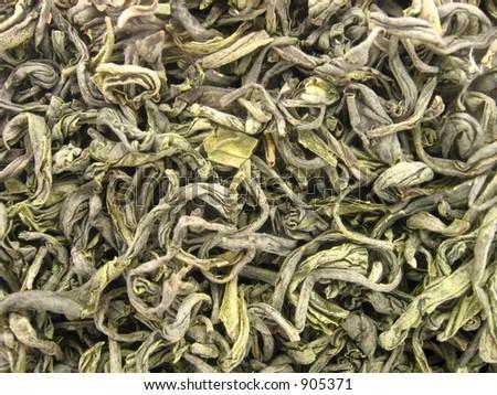 "Vietnamese green loose leaf tea ""Thai Nguyen"" Macro background"