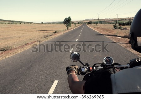 Vietnamese man travel to adventure nature, Viet Nam male ride motorbike on countryside street, lifestyle of youth people, couple make tour together , personality people with journey in Vietnam - stock photo