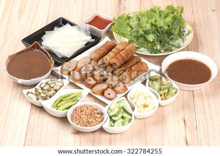 Vietnamese Meatball Wraps,Pork Sausage  wraps with vegetables (Nam-Neaung)Including tableware  - stock photo