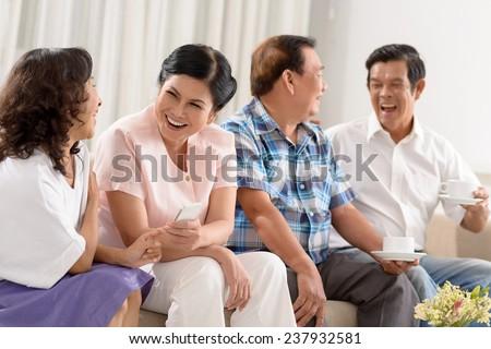 Vietnamese senior people having party at home - stock photo