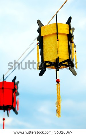 Vietnamese street decoration lantern on sky background - stock photo