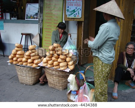 Vietnamese street vendor selling France loaf at street
