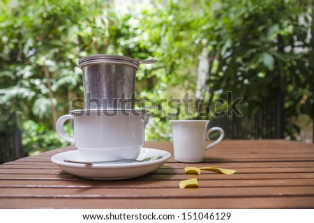 Vietnamese style of filtering coffee - stock photo