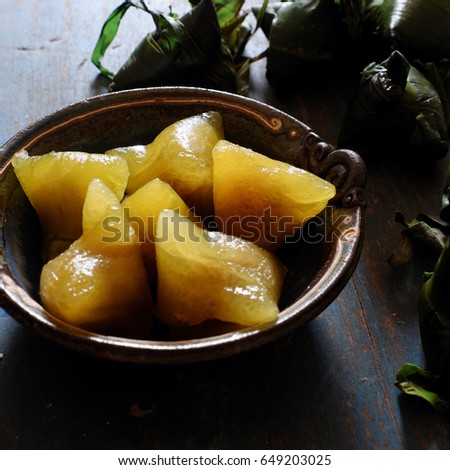 Vietnamese traditional food for may 5th, is double five festival or tet doan ngo, sticky rice cake in green leaf, also call banh u tro with pyramidal shape