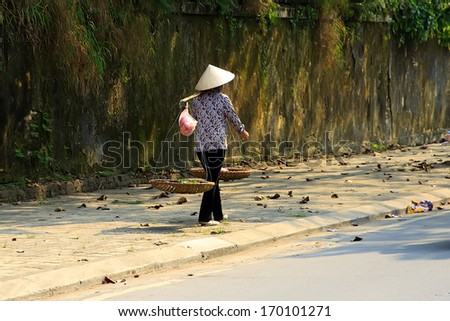 Vietnamese vendor in HANOI, VIETNAM - stock photo