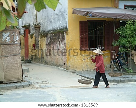 Vietnamese woman carrying load - stock photo