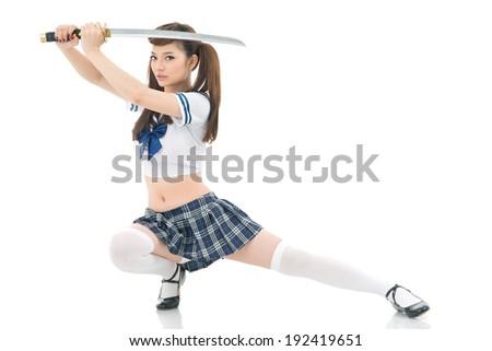 Vietnamese woman posing with katana - stock photo